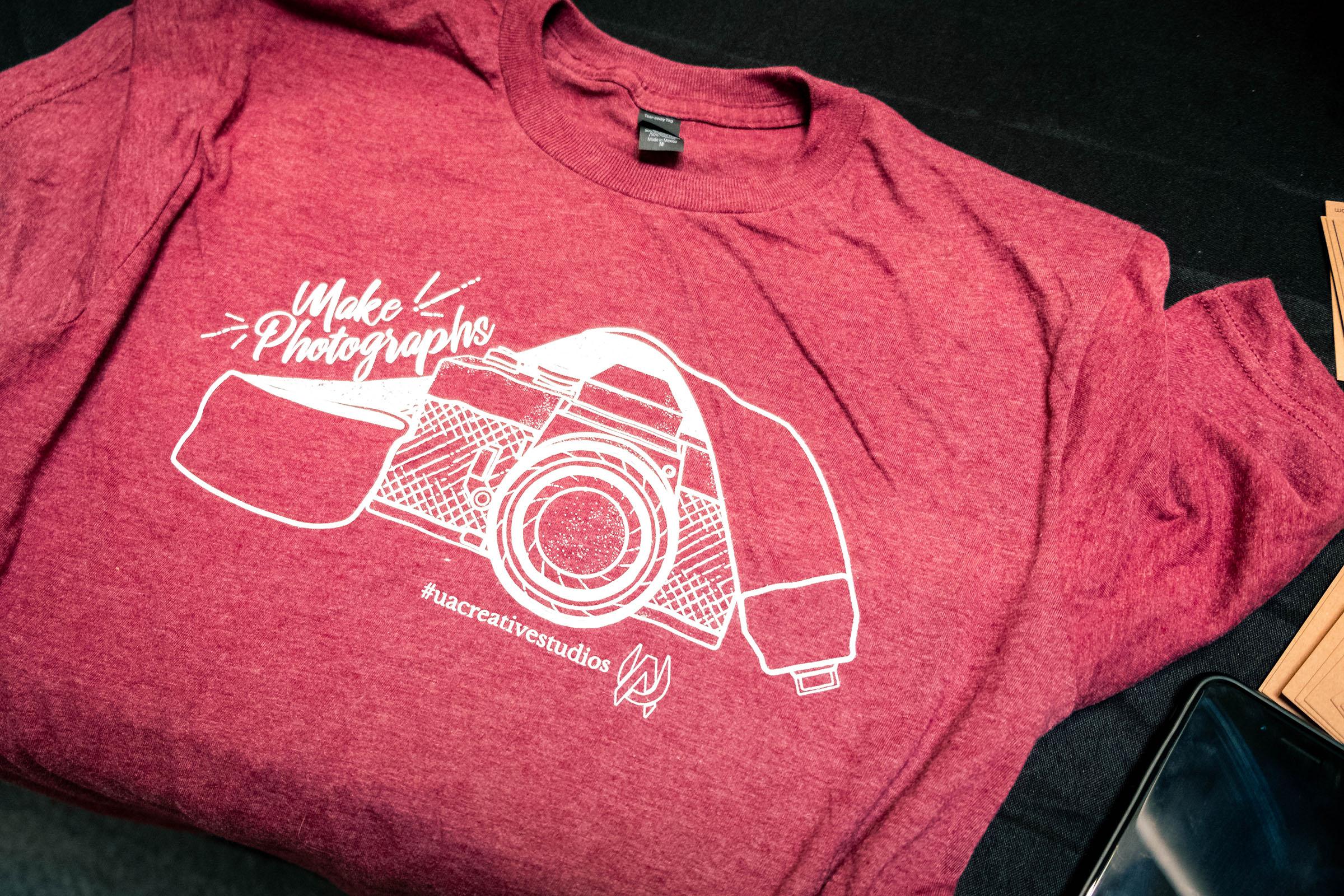 camera recycling event tee shirt
