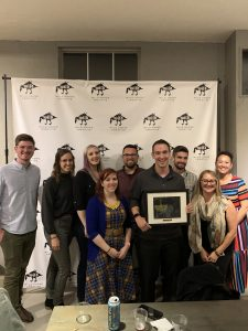 The UA Creative Studios team posing with their award at the 2019 Golden Goose Awards