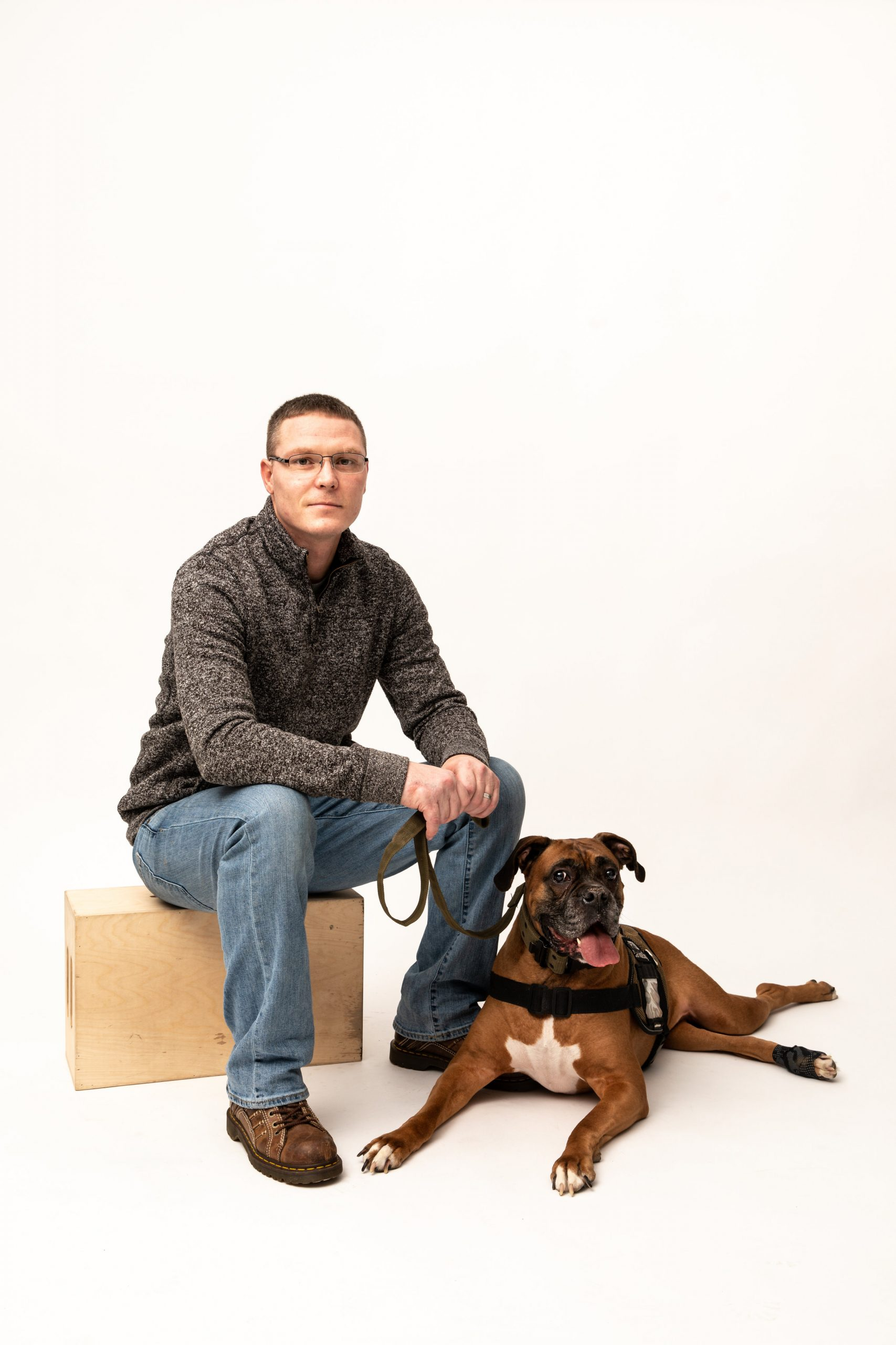 Veterans Companion Animal Services member poses with his service animal for a portrait